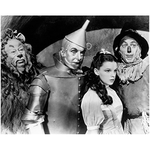 The Cowardly Lion (Bert Lahr), Tin Man (Jack Haley), Dorothy (Judy Garland), Scarecrow (Ray Bolger) all looking wide eyed