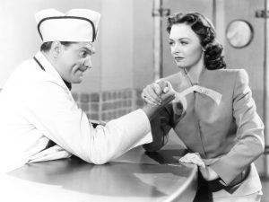 Red Skelton and Donna Reed doing his soda jerk routine in Thousand Cheer