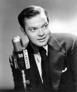 Young Orson Welles at the radio microphone