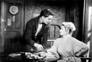 Nightmare Alley - Tyrone Power tries to get the secret of the code from Joan Blondell