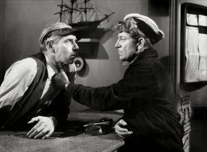 Bobo (Jean Gabin) intimidating someone while looking for Tiny