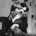Charlie Chaplin hugging The Kid