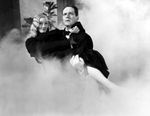 Frederic March rescues Veronic Lake from a burning hotel in I Married a Witch