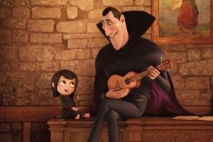 Young Mavis (Selena Gomez) being sung to by her father Dracula (Adam Sandler)