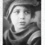 Jackie Coogan as The Kid