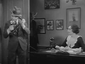 Edward G. Robinson on the phone following the story in Five Star Final