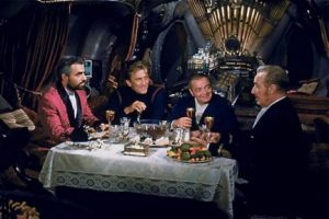In 20,000 Leagues Under the Sea, James Mason, Kirk Douglas, Peter Lorre and Paul Lukas discuss over dinner