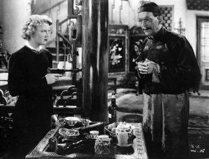 Jane Creed holds a gun on General Fang (Boris Karloff)