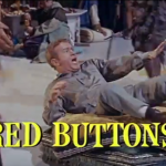 Donald O'Shay (Red Buttons) - the journalist who comes along to document the journey -- and whose uncle finances it