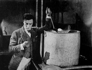 Buster Keaton trying to cook food in The Navigator