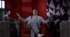 """Robert De Niro as Rupert Pupkin, with his cardboard cutout """"friends"""" in his mother's basement"""