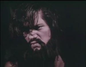 Richard Kiel, in an obviously fake beard, as Eegah