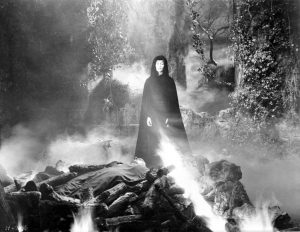 Dracula's Daughter destroys Dracula's corpse in fire, praying to the Almighty to free his spirit