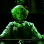 Stella Stevens as a gypsy, performing a seance