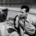 A romantic moment between Kent Taylor and Cathy Downs in The Phantom from 10,000 Leagues