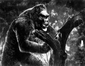 King Kong stores Fay Wray on a tree while he prepares to fight