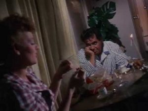 Lucille Ball and Desi Arnaz at the table
