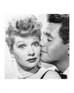 Lucille Ball kissed by Desi Arnaz
