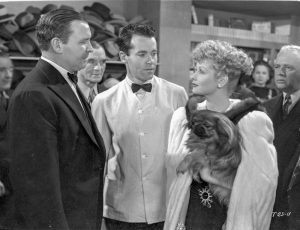 "At the nightclub, a scene between the mobster and his ""moll"" Lucille Ball - as Henry Fonda looks on helplessly"