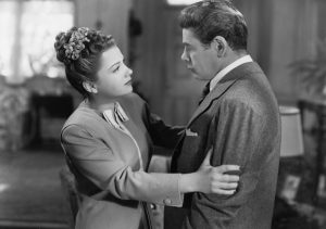 Anne Baxter as the Judge's fiancee with Paul Muni in his body