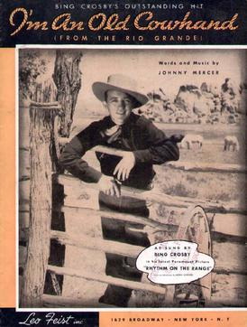 I'm An Old Cowhand song lyrics, a comic song written by Johnny Mercer for the film Rhythm on the Range and sung by Bing Crosby. Members of the Western Writers of America chose it as one of the Top 100 Western songs of all time.
