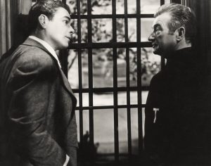 Paul Muni as the gangster and Claude Rains as the Devil (Nick) in Angel on My Shoulder