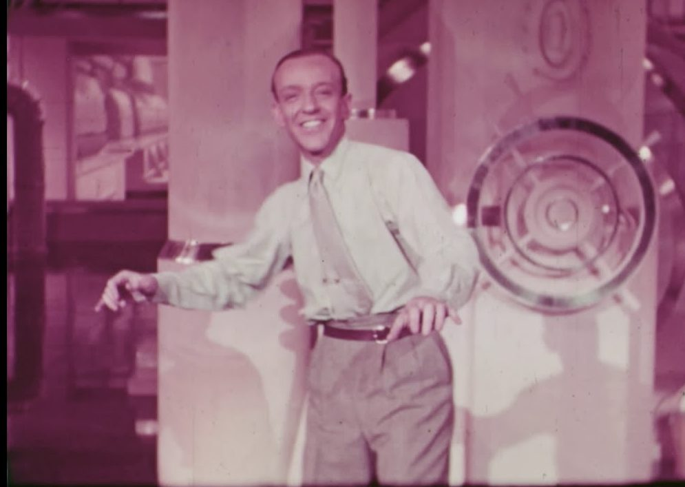 Song lyrics to Slap That Bass, Lyrics by Ira Gershwin, Music by George Gershwin, Sung and danced by Fred Astaire and Ensemble in engine room in Shall We Dance