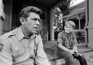 Andy Taylor talking with his son Opie about The New Housekeeper