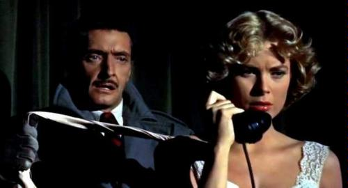Anthony Dawson about to attempt the murder of Grace Kelly in Dial M for Murder