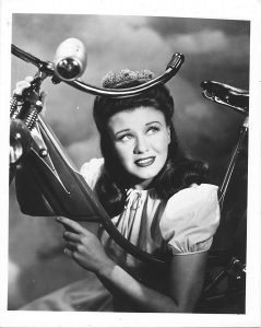 black and white photo of Ginger Rogers pretending to be twelve years old in The Major and the Minor