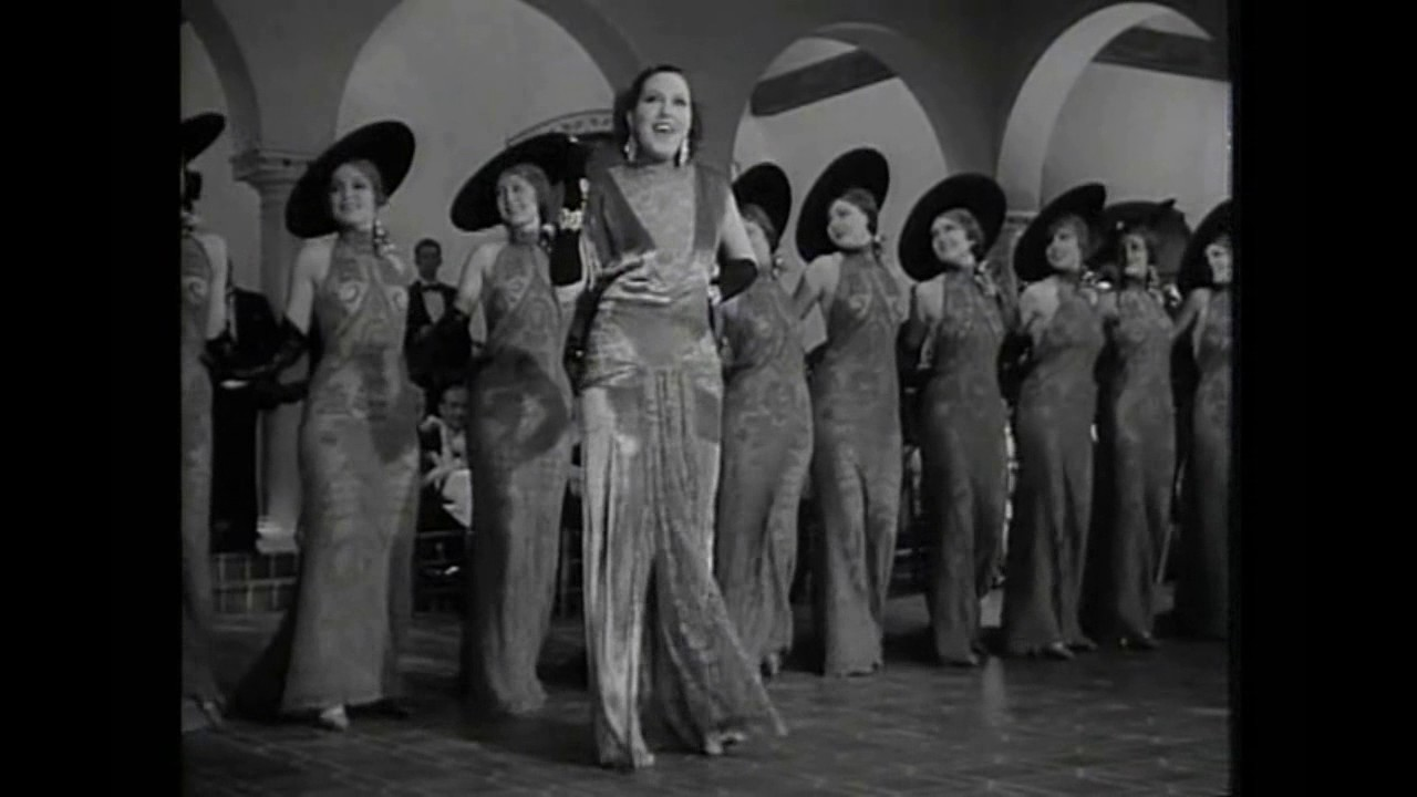 Song lyrics to The Lady in Red, music by Allie Wrubel, lyrics: Mort Dixon, from the film In Caliente, also performed by Desi Arnaz in the I Love Lucy episode Lucy is Enciente