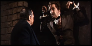Peter Lorre bricking up Vincent Price in a scene from The Cask of Amontillado/The Black Cat
