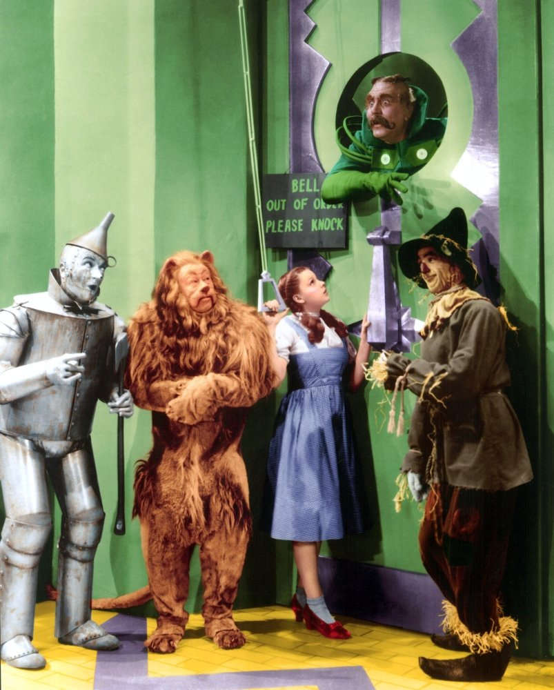 """Bell out of order, please knock - Ray Bolger, Judy Garland, Jack Haley and Bert Lahr in The Wizard of Oz - not to forget Frank Morgan, who played the doorman, as well as the horseman driving the """"horse of another color"""" in the following scene, and the Wizard of Oz himself."""