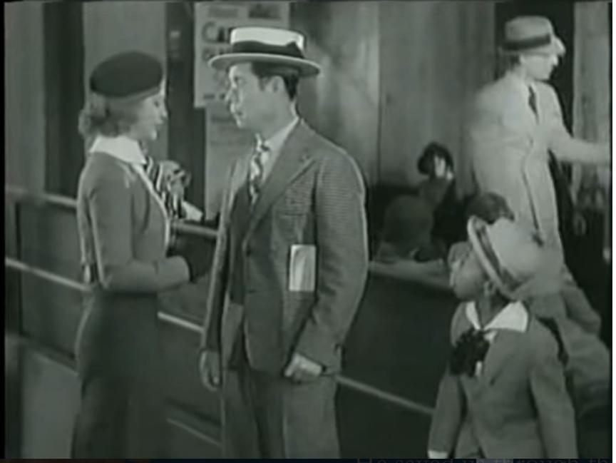 Alice Brandon (Ginger Rogers) meets Joe Holt (Joe E. Brown) as Sam (Farina) looks on