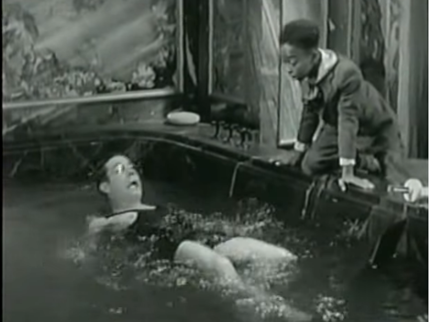 Joe learns to swim (in his unsinkable swimsuit) with Sam's help