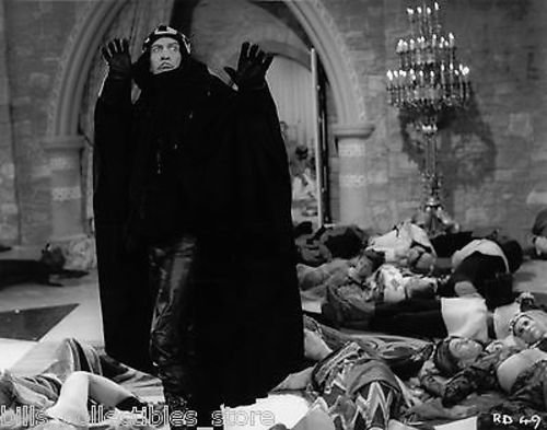 Prospero (Vincent Price) among the dead and dying in his castle in The Masque of the Red Death