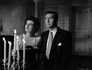 Ruth Hussey and Ray Milland in The Uninvited
