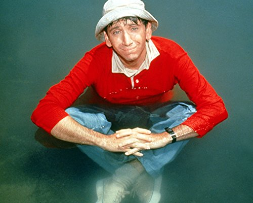 Bob Denver as Gilligan sitting in water