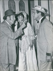 Paul Ford as Mayor George Shinn, Hermione Gingold as his wife Eulalie, confronting Harold Hill (Robert Preston)