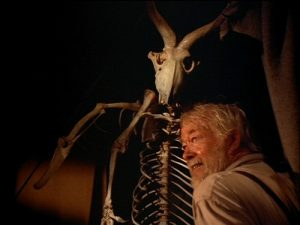 Uncle Willie showing off his authentic gargoyle skeleton in his museum of oddities
