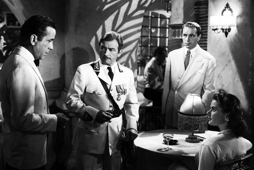 Rick, Captain Louis Renault, Paul Henreid, Ingrid Bergman at Rick's Cafe in Casablanca