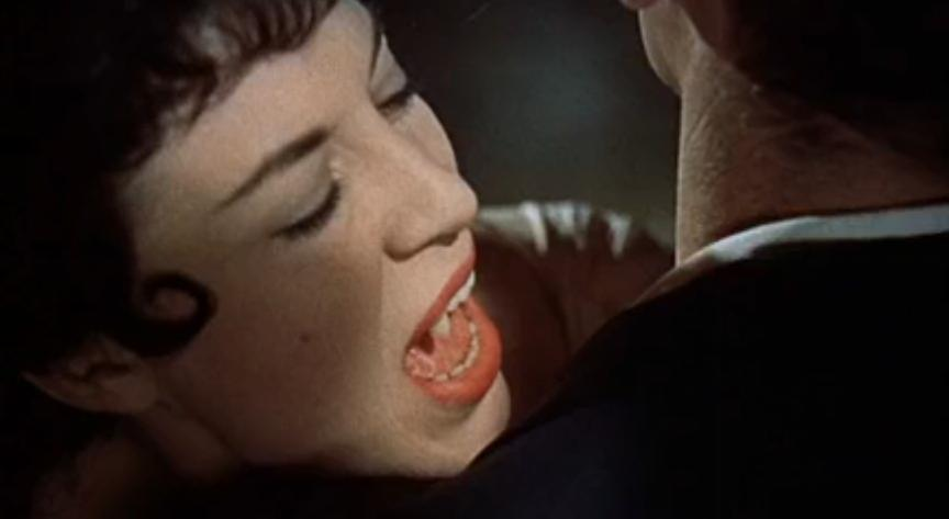 One of Dracula's (unnamed) brides, asking Harker for help … and about to feed