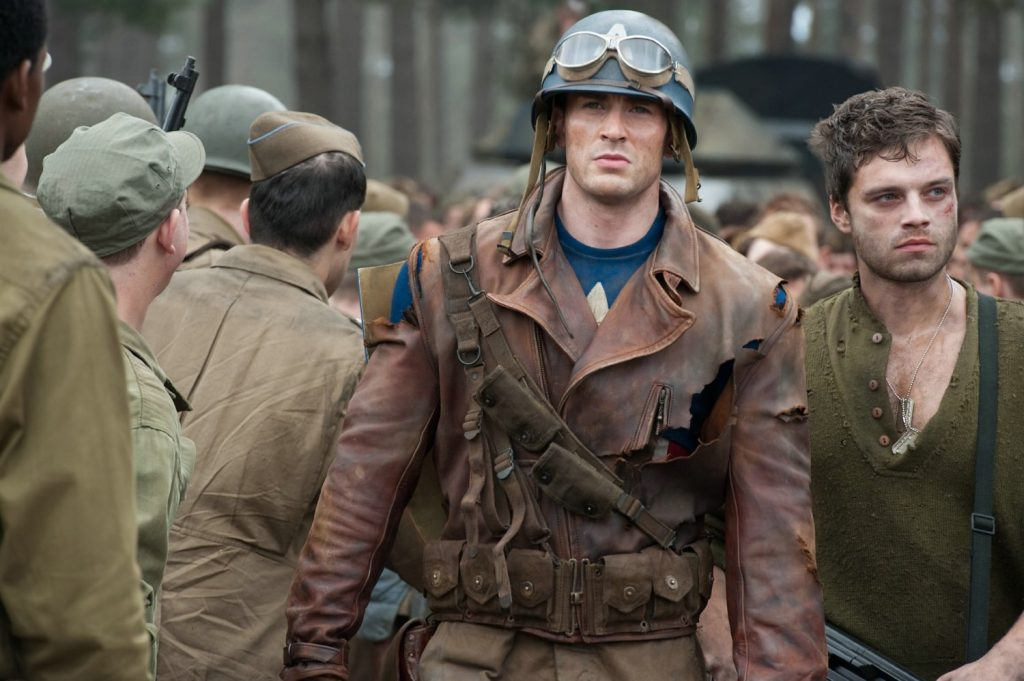 Captain America (Chris Evans) rescuing the Allied soldiers from Hydra
