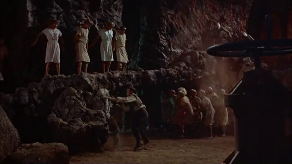 George fights the Morlocks with a lit torch … after generations of living underground, they fear the light.