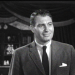 Alan Marshal as Dr. David Trent in House on Haunted Hill