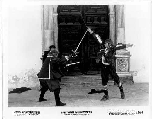 Michael York in a sword fight - a publicity photo from The Three Musketeers