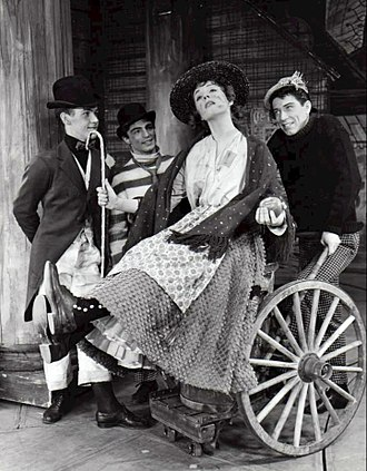 """Photo of Julie Andrews and cast from My Fair Lady. In this scene, Eliza and her friends dream of a better life-""""Wouldn't It Be Loverly?""""."""