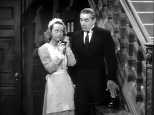 Janet Shaw as the maid, with Bela Lugosi as the butler who doesn't want her to make that phone call in Night Monster.