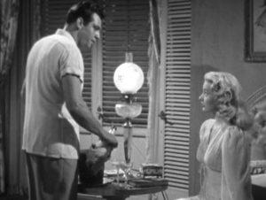 Barney Chavel (Raymond Burr) with his new wife Dina Van Gelder (Barbara Payton)