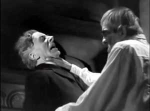 """Butler Ernest Thesiger being chocked by his """"dead"""" employer Professor Morland in """"The Ghoul"""".  You're fired!"""